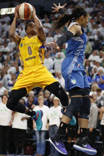 Sparks guard Alana Beard shoots against Minnesota's Maya Moore. (Stacy Bengs / Associated Press)