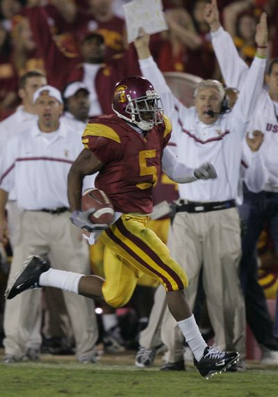 Pete Carroll, background right, had plenty to cheer about while coaching Reggie Bush at Southern California.  (Associated Press)