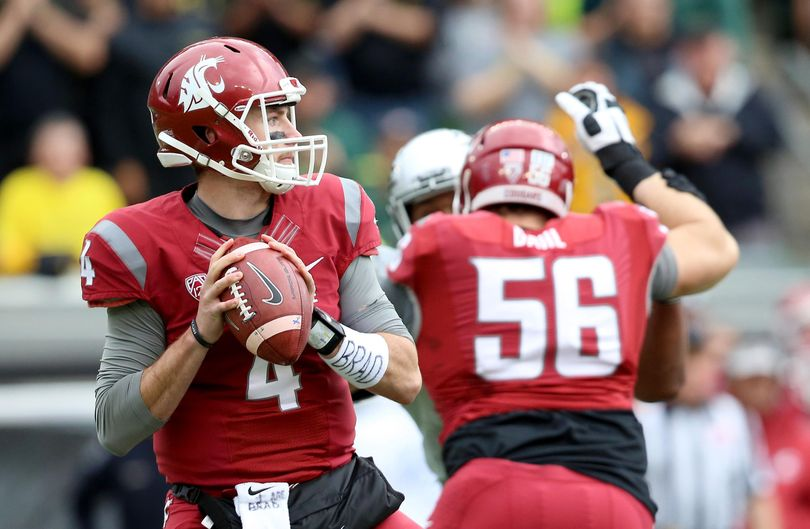 Washington State quarterback Luke Falk leads the Cougars against Eastern Washington in the teams' season opener Saturday in Pullman. (Ryan Kang / Associated Press)
