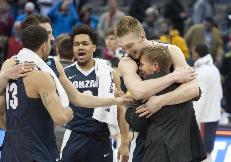Gonzaga's Domantaas Sabonis hugs head coach Mark Few after beating Utah at the Pepsi Center in Denver on Saturday, March 19, 2016. (Dan Pelle / The Spokesman-Review)