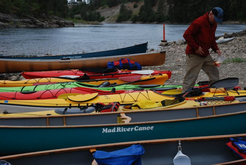 Boats of all descriptions are on the beach at Corbin Park in Post Falls ready for the start of Sunday's Spokane River Canoe Classic. (Rich Landers / The Spokesman-Review)