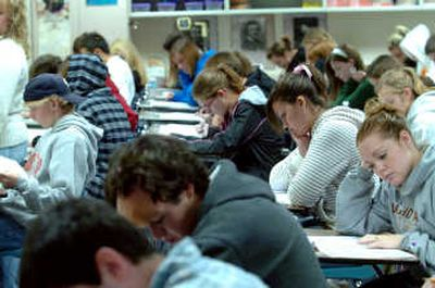 Coeur d'Alene High students hunch over the PSAT test Wednesday morning. More than 400 CHS students took the PSAT, Compass or ASVAB test this year.   (Jesse Tinsley / The Spokesman-Review)