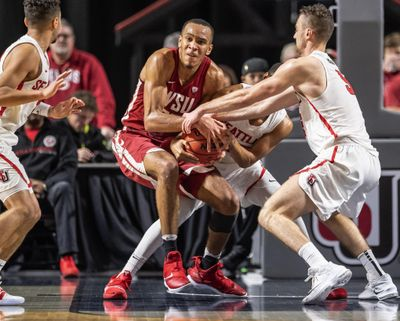 Seattle defenders get Washington State forward Arinze Chidom into a held ball during the first half of an NCAA college basketball game Wednesday, Nov. 14, 2018, in Kent, Wash. (Dean Rutz / AP)