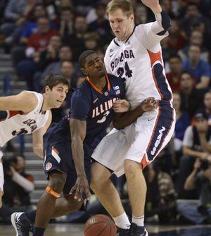 GU's Kelly Olynyk draws foul on UI's Myke Henry. (Dan Pelle)