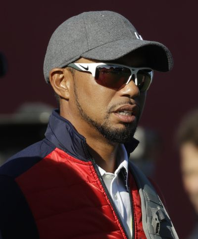 The comeback of Tiger Woods is going to have to wait at least two more months. Three days before he was to return at the Safeway Open, Woods said he wasn't ready to return against PGA Tour competition. (Chris Carlson / Associated Press)
