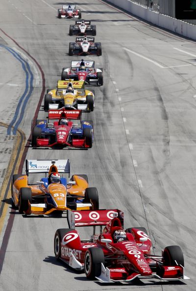 Scott Dixon leads a group of cars into the first turn at the Grand Prix of Long Beach. (Associated Press)