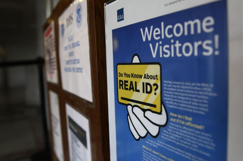 In this photo taken April 6, 2016, a sign at the federal courthouse in Tacoma is shown to inform visitors of the federal government's REAL ID act, which requires state driver's licenses and ID cards to have security enhancements and be issued to people who can prove they're legally in the United States. (Ted S. Warren / Associated Press)