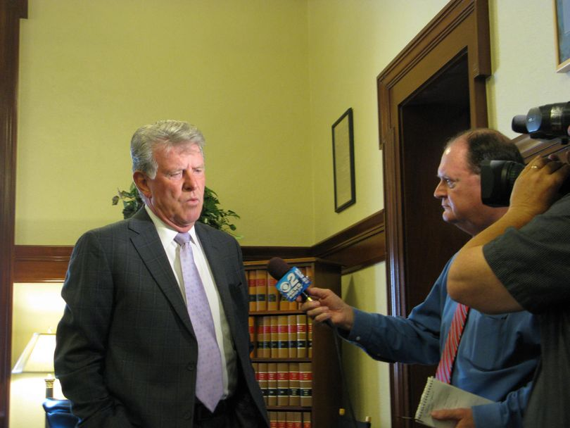 Idaho Gov. Butch Otter answers questions from TV reporter Scott Logan after voting Monday to pay attorney fees to the winning sides in three big lawsuits. (Betsy Z. Russell)