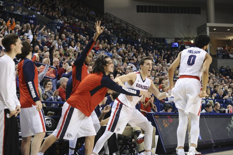 Gonzaga's bench congratulates guard Silas Melson (0) after he hit a three pointer against San Francisco during a college basketball game on Saturday, Jan. 30, 2016, at McCarthey Athletic Center in Spokane, Wash. (Tyler Tjomsland / The Spokesman-Review)
