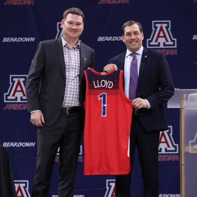 Arizona basketball coach Tommy Lloyd, left, and athletic director Dave Heeke pose during Lloyd's introductory news conference Thursday in Tucson, Arizona.  (Courtesy of Arizona athletics)