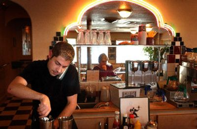 Top Notch Cafe owner Cliff Daigler filled an order Wednesday.   (Brian Plonka / The Spokesman-Review)