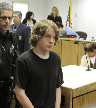 Zachary Neagle is led away from the courtroom after his sentencing May 12, 2010 at Canyon County Courthouse in Caldwell, Idaho. In May 2009, Neagle killed his 32-year-old father, Jason Neagle, in their Caldwell home. When his defense argued that years of sexual abuse prompted the killing, national and international news outlets swarmed to Canyon County to cover the story of a 14-year-old who said he did it to protect his siblings. (Mike Vogt / Mike Vogt/The Idaho Press-Tribune)
