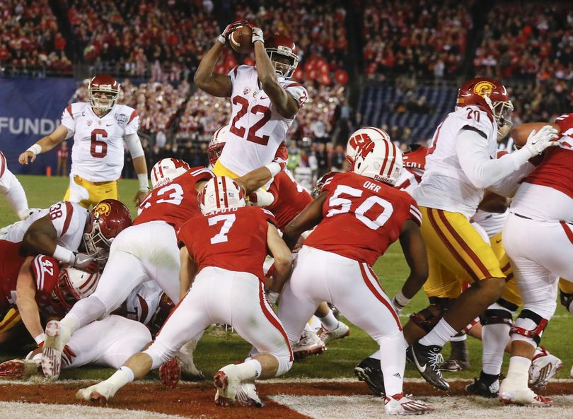 Southern California running back Justin Davis (22) scores a touchdown during the first half of the Holiday Bowl.