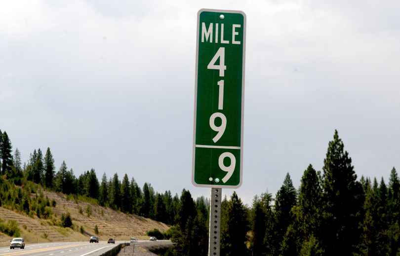 Cars stream past milepost 419.9 just south of Coeur d'Alene on U.S. Highway 95 on Tuesday. Idaho joins Colorado in replacing its milepost 420 signs with milepost 419.9 designations in an effort to thwart growing thievery. Authorities suspect the signs are prized among potheads enamored with its drug culture double-entendre. (Kathy Plonka)