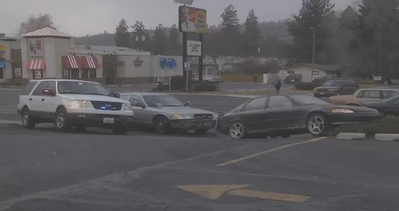 A man in a stolen car swerved into a police cruiser during a chase in north Spokane Tuesday afternoon.