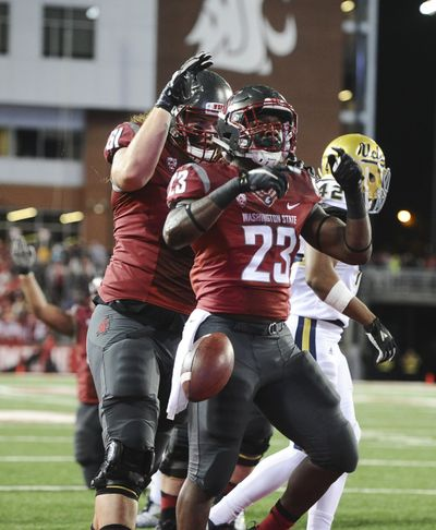 Washington State Cougars running back Gerard Wicks (23) celebrates the end zone after punching through the line to score against UCLA during the first half of a PAC 12 college football game on Saturday, Oct 15, 2016, Martin Stadium in Pullman, Wash. (Tyler Tjomsland / The Spokesman-Review)