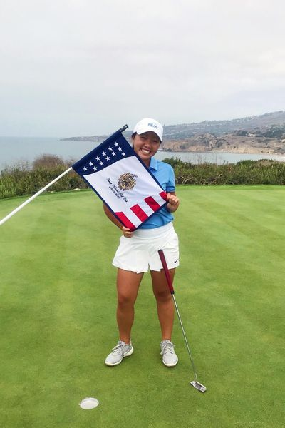 This Aug. 23, 2019, photo provided by Greg Borchers shows Kayli Lucas posed on the 18th green at Trump National in Los Angeles, where she was part of an elite group of juniors from The First Tee to spend a day with Nick Faldo. Kayli's next stop is to play with pros this week at Pebble Beach in a PGA Tour Champions event. (Greg Borchers / Associated Press)