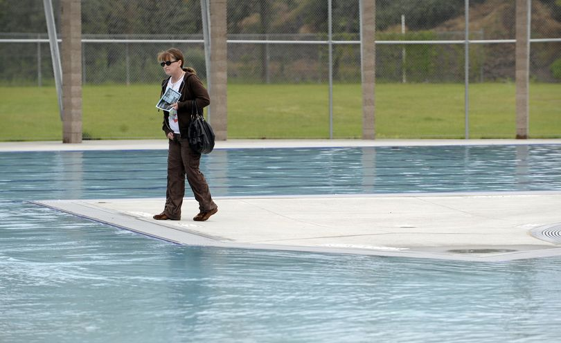 Glenna Poblete, who lives next door to the new Liberty Aquatics Center at Fifth and Pittsburgh in the east central neighborhood, explores the new facility Wednesday, June 9, 2010, after the pool's dedication. (Jesse Tinsley / The Spokesman-Review)