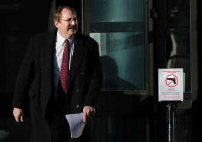 Former Deputy U.S. Marshal David Brodhagen exits the U.S. Courthouse in downtown Spokane after pleading guilty Wednesday to a federal charge of  lying about a college degree on job promotion papers. Brodhagen used a bogus degree purchased from a Spokane-based diploma mill.  (Rajah Bose / The Spokesman-Review)