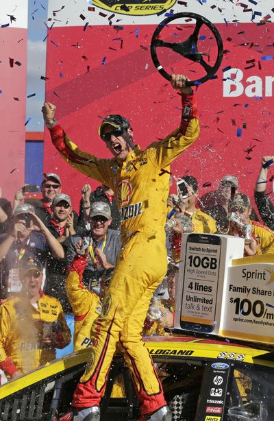 Joey Logano celebrates in Victory Lane after winning the NASCAR Sprint Cup series auto race at Charlotte Motor Speedway in Concord, N.C., Sunday, Oct. 11, 2015. (AP Photo/Chuck Burton) ORG XMIT: NCCB120 (Chuck Burton / AP)