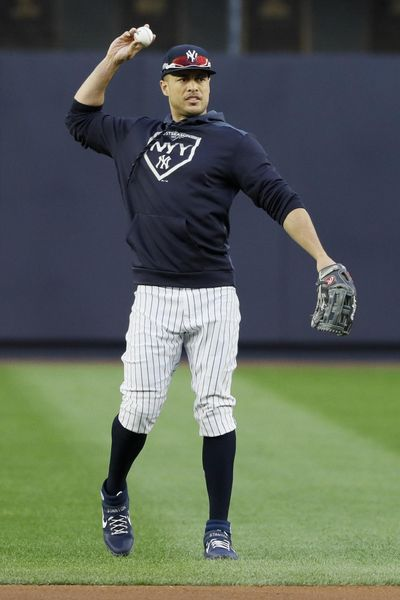 New York Yankees left fielder Giancarlo Stanton warms up during batting practice before Game 4 of baseball's American League Championship Series against the Houston Astros Thursday, Oct. 17, 2019, in New York. (Matt Slocum / Associated Press)