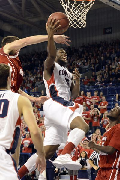 South Dakota's Tyler Flack swats at the ball as Gonzaga's Gary Bell Jr. goes for a layup in the second half. Gonzaga beat South Dakota 96-58. (Associated Press)