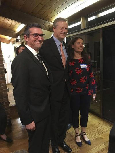 In this Oct. 23, 2017 photo provided to the AP, Martin Marro, left, and his wife, Mariana Dagatti, right, pose for a photo with Massachusetts Gov. Charlie Baker in Newton, Mass. The Argentine foreign ministry said Marro is recovering from his injuries at a Manhattan hospital after the Tuesday, Oct. 31 bike path attack. (Tom Mountain / Associated Press)