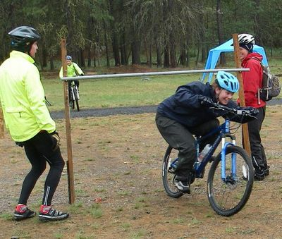 A participant ducks through the limbo station in the Mountaineers Mountain Biking Clinic. Photo courtesy of Spokane Mountaineers (Photo courtesy of Spokane Mountaineers / The Spokesman-Review)