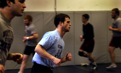 North Idaho College wrestler Tim McGoldrick runs during practice in preparation for the NJCAA national championships this weekend. (Kathy Plonka / The Spokesman-Review)