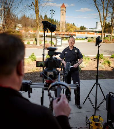 Spokane police Capt. Tracie Meidl films a police recruitment video in Riverfront Park on April 15.  (COLIN MULVANY/THE SPOKESMAN-REVIEW)