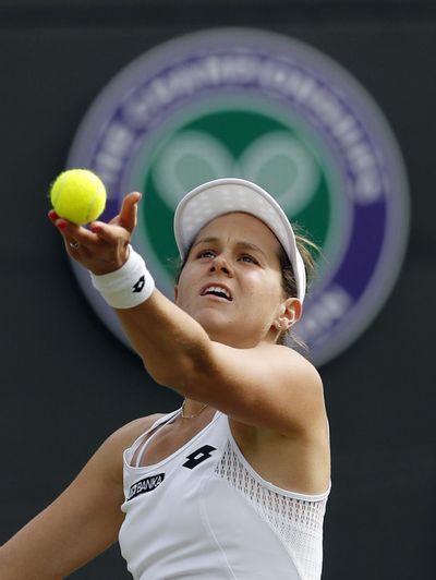Jana Cepelova of Slovakia defeated Garbine Muguruza of Spain during their women's singles match on day four of Wimbledon. (Ben Curtis / Associated Press)