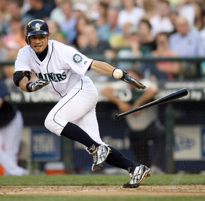 Mariners' Ichiro Suzuki lays down a sacrifice bunt in fifth inning. He extended his hitting streak to 27 games in the third inning. (Associated Press / The Spokesman-Review)