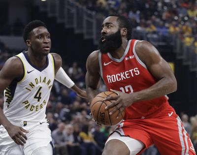 Houston's James Harden drives to the basket against Indiana's Victor Oladipo during first-half action on Monday in Indianapolis. (Darron Cummings / AP)