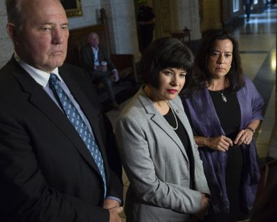 Minister of Justice and Attorney General of Canada Jody Wilson-Raybould, right, Minister of Health Ginette Petitpas Taylor, center, and Parliamentary Secretary to the Minister of Justice and Attorney General of Canada and to the Minister of Health Bill Blair, left, listen to questions during a press conference on Bill C-45, the Cannabis Act, in the Foyer of the House of Commons on Parliament Hill in Ottawa, Ontario on Wednesday, June 20, 2018. (Justin Tang / Canadian Press)