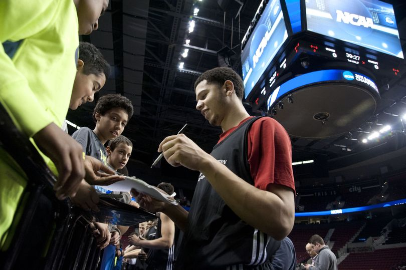 EWU's Tyler Harvey signs autographs for children after his team's practice session Wednesday in Portland's Moda Center. (Dan Pelle)