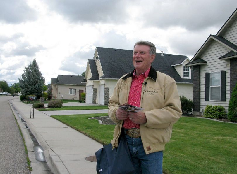 Idaho Gov. Butch Otter stops to talk with reporters while campaigning door-to-door in Meridian last weekend. (Betsy Russell)