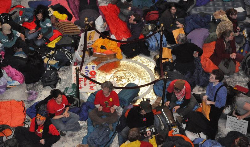 Protesters prepare for a night in the Capitol with sleeping bags laid out on the Rotunda floor. (Jim Camden/The Spokesman-Review)
