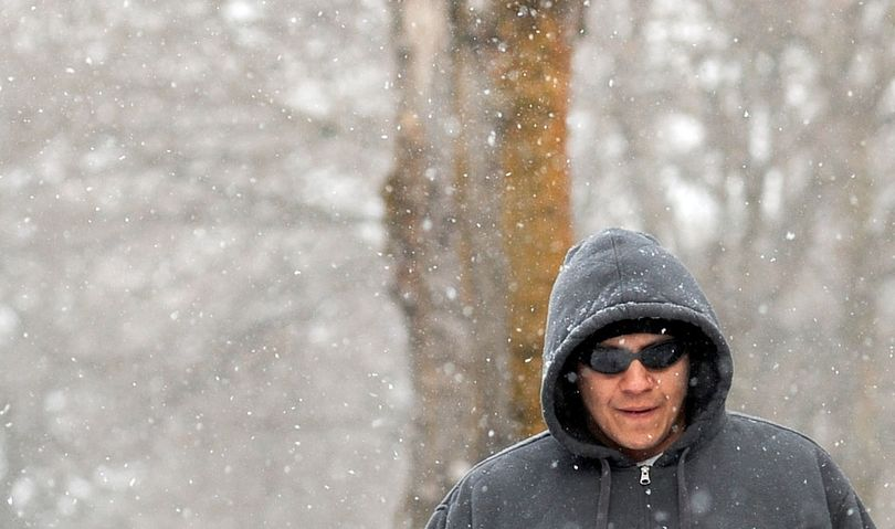 """Out for a winter walk: """"The sidewalks are slippery,"""" said Lawrence Bradford, of Coeur d'Alene, as he walked along Fifth Street on Tuesday. (Kathy Plonka)"""