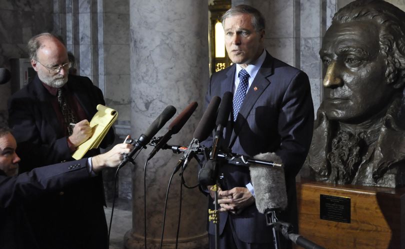OLYMPIA -- Gov. Jay Inslee holds a press conference in a Capitol Hallway to call for support for a package of legislation to secure Boeing's 777X assembly line and production facility. (Jim Camden)