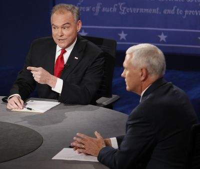 Republican vice-presidential nominee Gov. Mike Pence, right, and Democratic vice-presidential nominee Sen. Tim Kaine speak during the vice-presidential debate at Longwood University in Farmville, Va., Tuesday, Oct. 4, 2016. (Andrew Gombert / AP)