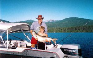 Quinn Kopczynski, 7, of Spokane needed help from his father, Chris Kopczynski, last summer (2005)to lift this huge 38 1/2 inch long mackinaw. Quinn caught the mack at Priest Lake while trolling using a spining rod and six-pound test line.   (Photo courtesy of Chris Kopczynski / The Spokesman-Review)