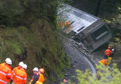 An Amtrak train is shown after it derailed Sunday near White Salmon, Wash. The Portland-bound train was carrying 115.   (Associated Press / The Spokesman-Review)