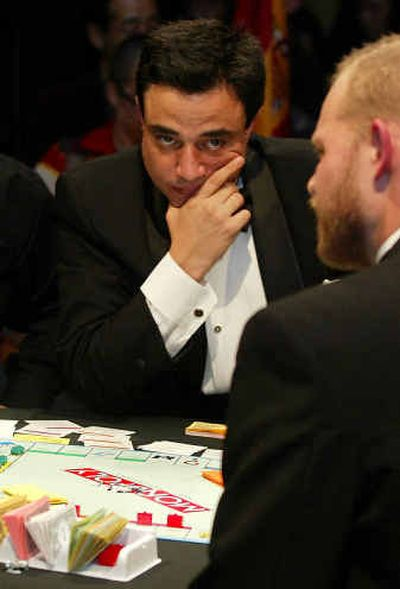 Spain's Antonio Zafra Fernandez, 36, looks at Norway's Bjorn Andenaes, right, during the final of the World Monopoly Championship Saturday  in Tokyo. Spain's Antonio Zafra Fernandez, 36, looks at Norway's Bjorn Andenaes, right, during the final of the World Monopoly Championship Saturday  in Tokyo.   (Associated PressAssociated Press / The Spokesman-Review)