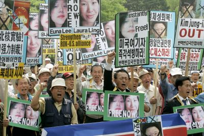 Protesters shout slogans during a rally Thursday  in Seoul, South Korea, held to coincide with the trial in North Korea  of two American journalists.  (Associated Press / The Spokesman-Review)