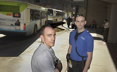 Security  officers Chris Hamilton, left, and Chris Stein, shown Thursday at the downtown STA Plaza,  chased and detained an armed robbery suspect in February. (CHRISTOPHER ANDERSON / The Spokesman-Review)