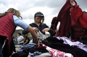 Crystal Larson, left, and Amy Demeerleer sort through clothes at the Liberty Lake Community Yard Sale on Saturday morning. More than 260 homes participated in the event, selling everything from lampshades to motorbikes.   (Holly Pickett / The Spokesman-Review)