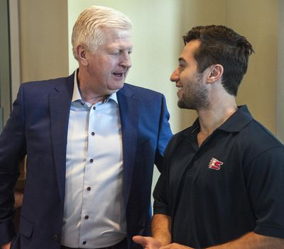 Chiefs general manager Tim Speltz, left, and former Chiefs' great Tyler Johnson chat before announcement. (Dan Pelle / The Spokesman-Review)