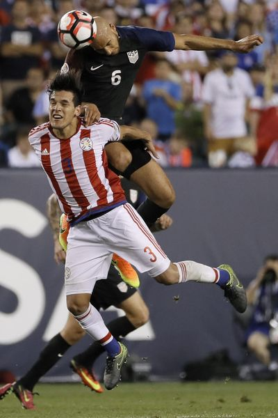 United States' John Brooks, top, and Paraguay's Gustavo Gomez leap for the ball during the second half of a Copa America Group A soccer match Saturday in Philadelphia. The U.S. won 1-0. (Matt Slocum / Associated Press)