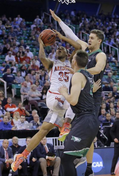 North Dakota's Carson Shanks, right, and Drick Bernstine, center, defend against Arizona guard Allonzo Trier (35) during the second half of a first-round game in the NCAA men's college basketball tournament Thursday, March 16, 2017, in Salt Lake City. (Rick Bowmer / Associated Press)