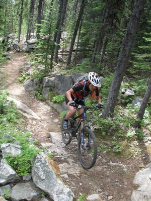 Seattle-area mountain biker Mire Levy rides a rugged, rocky portion of the Kettle Crest Trail toward Sherman Peak south of Sherman Pass.  (Tim Banning)